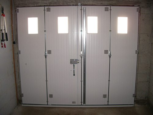 Baies fermetures grenoble fen tres volets baies portes stores for Porte de garage battant alu